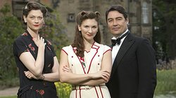 Sophie Ward as Lady Ellen Hoxley, Summer Strallen as Nancy Morrell, and Nathaniel Parker as Lord Lawrence Hoxley in LAND GIRLS.