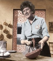 Julia Child is credited with introducing French cooking techniques to mainstream America in THE FRENCH CHEF, which began in 1963. Here, she prepares a chocolate mousse.