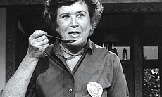Julia Child is credited with introducing French cooking techniques to mainstream America in THE FRENCH CHEF, which began in 1963. Here, she samples her own cooking.