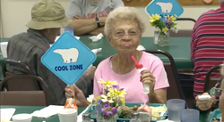 A woman stays out of the heat at one of San Diego County's cool zone locations.  The County's Department of Aging and Independent Services has more than 100 cool zones located at libraries, community centers and churches.