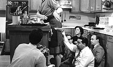 Julia Child is credited with introducing French cooking techniques to mainstream America in THE FRENCH CHEF, which began in 1963. She's shown here with the television crew.