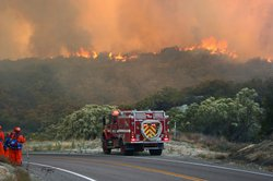 Firefighters battle the Chihuahua Fire in Warner Springs, which was sparked b...