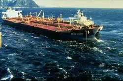 The Exxon Valdez three days after the vessel grounded, just before a storm ar...