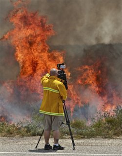 KPBS videographer Christopher Maue shoots near the Vallecito Lightning Comple...