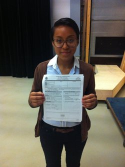 Lupe Sandoval holding her application