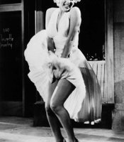 "Marilyn Monroe posing during the famous subway grate scene from ""The Seven Year Itch,"" 1954. Photographed by Sam Shaw."