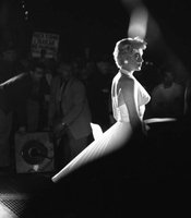 "Marilyn Monroe between poses during the famous subway grate scene from ""The Seven Year Itch,"" 1954. Photographed by George S. Zimbel."