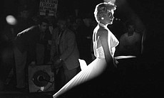 "Marilyn Monroe between poses during the famous subway grate scene from ""The S..."