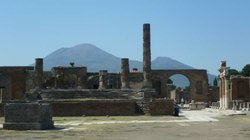 Ruins of Pompeii, viewed from the Forum looking towards the Temple of Jupiter, with Mount Vesuvius in the distance.