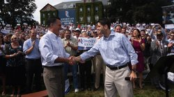 Republican presidential candidate Mitt Romney, left, shakes hands with his ch...