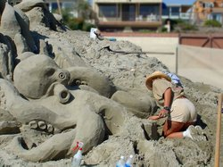A woman competes at the Sandcastle Sculpting Challenge.