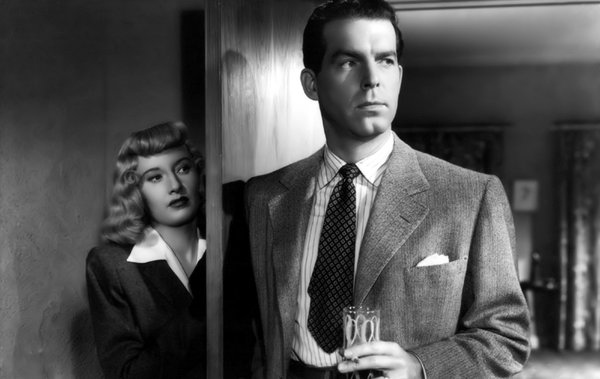 "Barbara Stanwyck and Fred MacMurray in Billy Wilder's film noir classic ""Double Indemnity."""