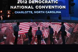 People are seen on stage as preparations are made at the Time Warner Cable Arena for the Democratic National Convention Committee on September 1, 2012 in Charlotte, North Carolina.
