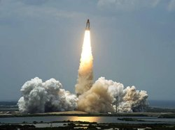 From Launch Pad 39A at NASA's Kennedy Space Center in Florida, space shuttle Atlantis roars into the sky on a column of fire on the STS-125 mission to service NASA's Hubble Space Telescope.