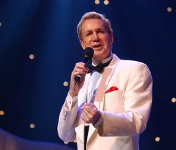 "Tom Netherton of television's ""Lawrence Welk Show"" performs ""Find Us Faithful"" during the taping of the all-new PBS special, ""Lawrence Welk Precious Memories."""