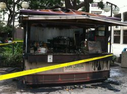 The Ja Java coffee cart after it was burned by a suspected arsonist on September 12, 2012.