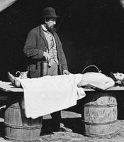 Dr. Richard Burr at work embalming a soldier's body in 1860.