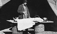 Dr. Richard Burr at work embalming a soldier's ... (18968)