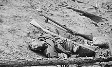 Dead Confederate soldier from the siege of Petersburg in the trenches at Fort Mahone in Petersburg, Virginia, April 3, 1865.