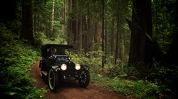 Re-creation: 1917 Buick Touring Car on the original Highway 101 in Del Norte Redwoods State Park.