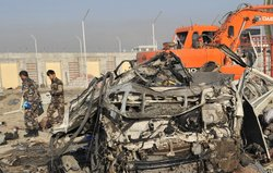 A suicide bomber struck a convoy of buses today in Kabul, killing at least 12...