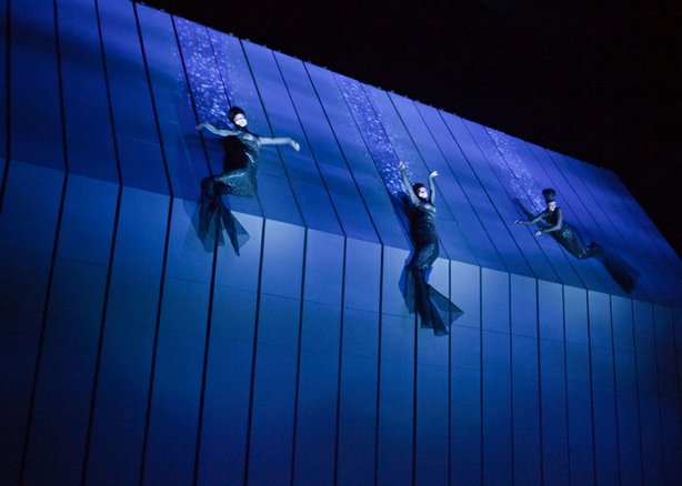 "The Rheinmaidens (Jennifer Johnson, Lisette Oropesa, and Tamara Mumford) in a scene from Robert Lepage's production of Wagner's ""Das Rheingold."""