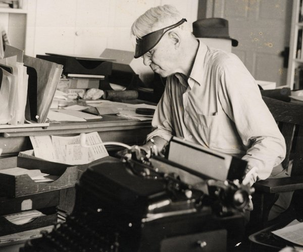 Carl Sandburg with his typewriter at Connemara in Flat Rock, N.C.