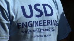 USD engineering students wear T-shirts heralding today's announcement of a $2...