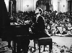 Van Cliburn performing in the Great Hall of the Moscow Conservatory during th...