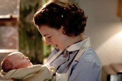 Jessica Raine as Jenny Lee holding a new born baby in CALL THE MIDWIFE.