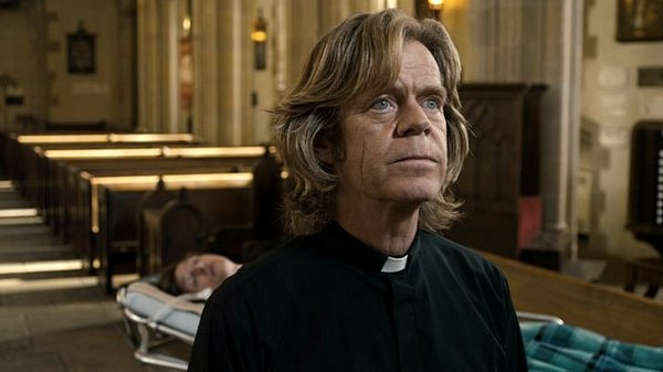 "William H. Macy as Father Brendan in ""The Sessions."""