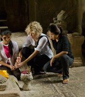 Meg Ryan with Somana Long and Srey Pov at Angkor Wat in Siem Reap, Cambodia.