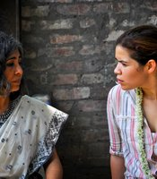New Light founder and director Urmi Basu with America Ferrera in Khaligat, India.