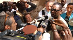 Senegalese superstar Youssou N'Dour speaks to the media during his run for th...