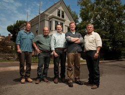 The crew of THIS OLD HOUSE: landscape contractor Roger Cook, plumbing and heating expert Richard Trethewey, master carpenter Norm Abram, host Kevin O'Connor and general contractor Tom Silva, in front of the Cambridge house.
