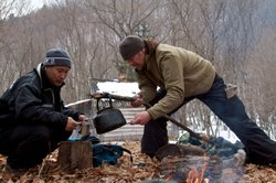 Meal times on the trail can be basic. Having to carry everything they will want during a day's hike Chris Morgan is seen here in tiger country, pouring a cup of tea for his companion, Korean filmmaker Sooyong Park.