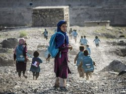 Afghan children run to school on Sept. 24. Whoever takes over as the next U.S...