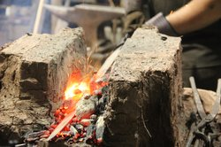 Blacksmith Ric Furrer heats the crucible Ulfberht blade in a traditional bric...