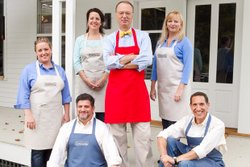 The cast of COOK'S COUNTRY FROM AMERICA'S TEST KITCHEN, pictured left to right, Julia Collin, Erin McMurrer, Christopher Kimball, Bridget Lancaster and in the front row, Adam Reid and Jack Bishop.