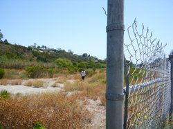 A swath of land along Home Avenue in City Heights has been fenced off since t...