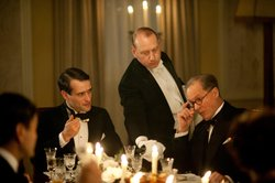 Ed Stoppard as Sir Hallam Holland, with William Hope as Ambassador Kennedy and Adrian Scarborough as Mr. Pritchard. Ambassador Kennedy and his dashing son Jack come to dinner at Eaton Place. But Agnes is more entranced by another guest: millionaire Caspar Landry. Before the evening is over, Mrs. Thackeray resigns.