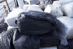 Several bales of marijuana sit on the deck of a U.S. Coast Guard cutter after...