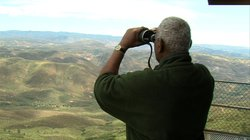 Norm Mitchell scanning the countryside for signs of smoke.
