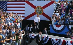 U.S. President Barack Obama walks on stage during a campaign rally at the Del...
