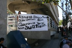 Protesters hold a banner on a pedestrian bridge in Nogales, Mexico, asking fo...
