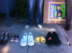 DREAM Act supporters, some of them undocumented, brought shoes to a protest a...