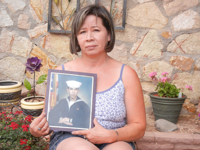 Ruth Rivas with a photo of her son Adam Hernandez