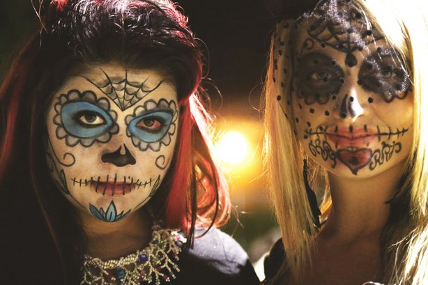 Valeria Pearson, left, and Jessica Perry took a couple of hours to paint their faces like sugar skulls for Dia de los Muertos. The celebration in Las Vegas takes place at the Winchester Cultural Center.