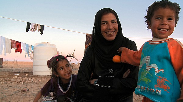 Rafea in the village with her son and daughter.