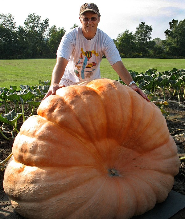Competitor Joe Pukos with his giant pumpkin.